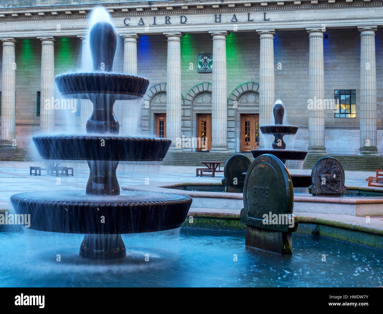 Fountains and Coloured Lights on Caird Hall at Dusk in Dundee Scotland - Stock Image