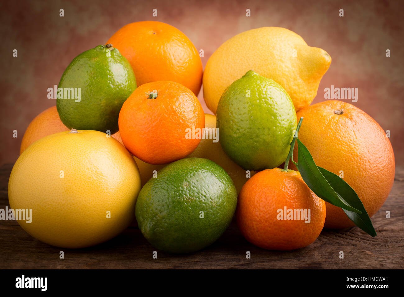 citrus fruits on wooden background - Stock Image