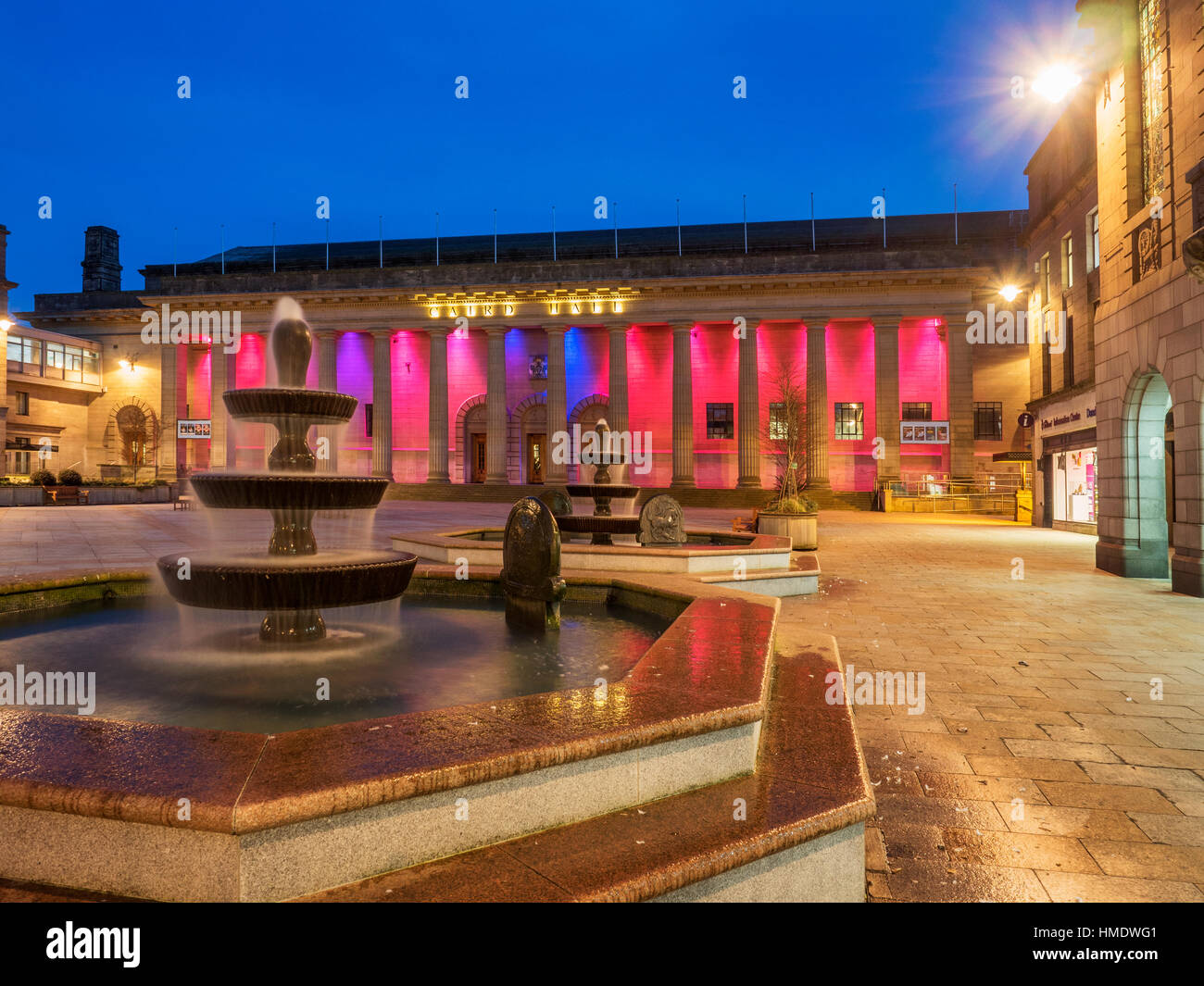 Fountains in City Square and Coloured Lights on Caird Hall at Dusk  Dundee Scotland - Stock Image