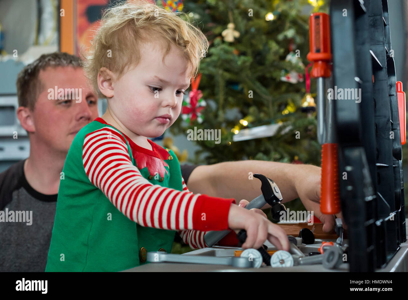Denver, Colorado - Adam Hjermstad Jr., 2 1/2, plays with a tool set he got for Christmas as his dad, Adam Hjermstad - Stock Image