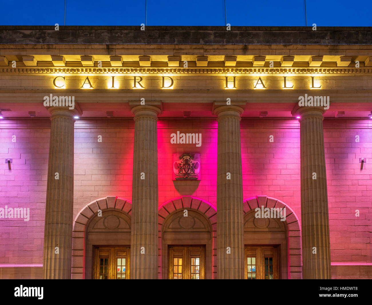 Coloured Lights on Caird Hall at Dusk Dundee Scotland - Stock Image