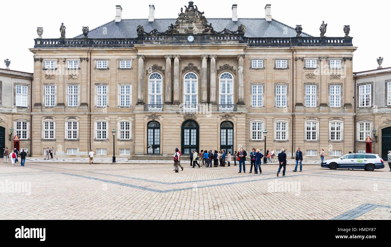 COPENHAGEN, DENMARK - SEPTEMBER 10, 2011: tourists near royal Christian VIII Palace in Amalienborg of Copenhagen Stock Photo