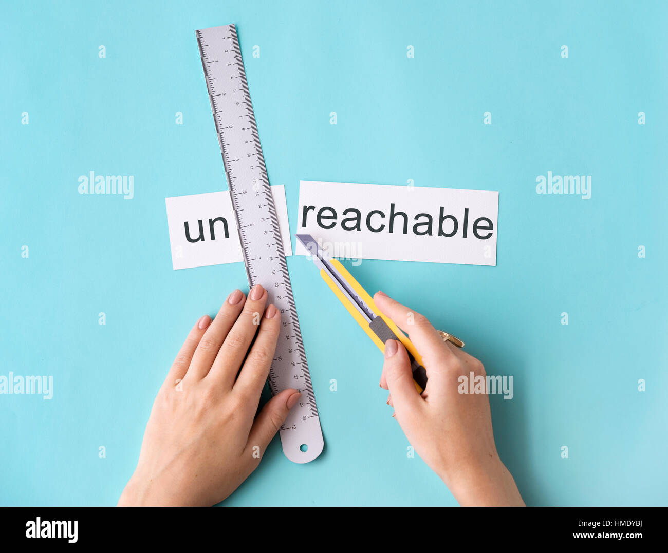 Unreachable Unattainable Hand Cut Words Split Concept - Stock Image