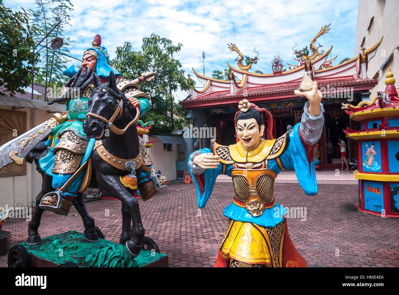 Statues of a warrior and Kwan Kong (Guan Yu) god riding a horse. © Reynold Sumayku - Stock Image