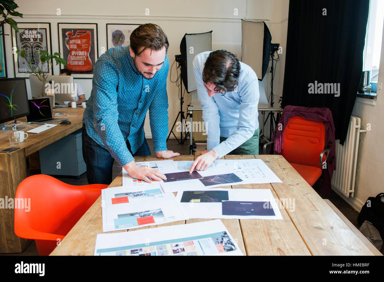 Utrecht, Netherlands. Two professional, creative males and artists explaining their work in the creation of the - Stock Image