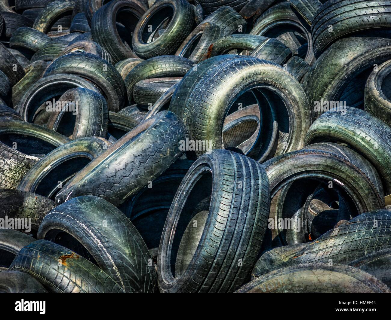 Old, discarded motor vehicle tyres. Cape Flats, Cape Town, South Africa. - Stock Image