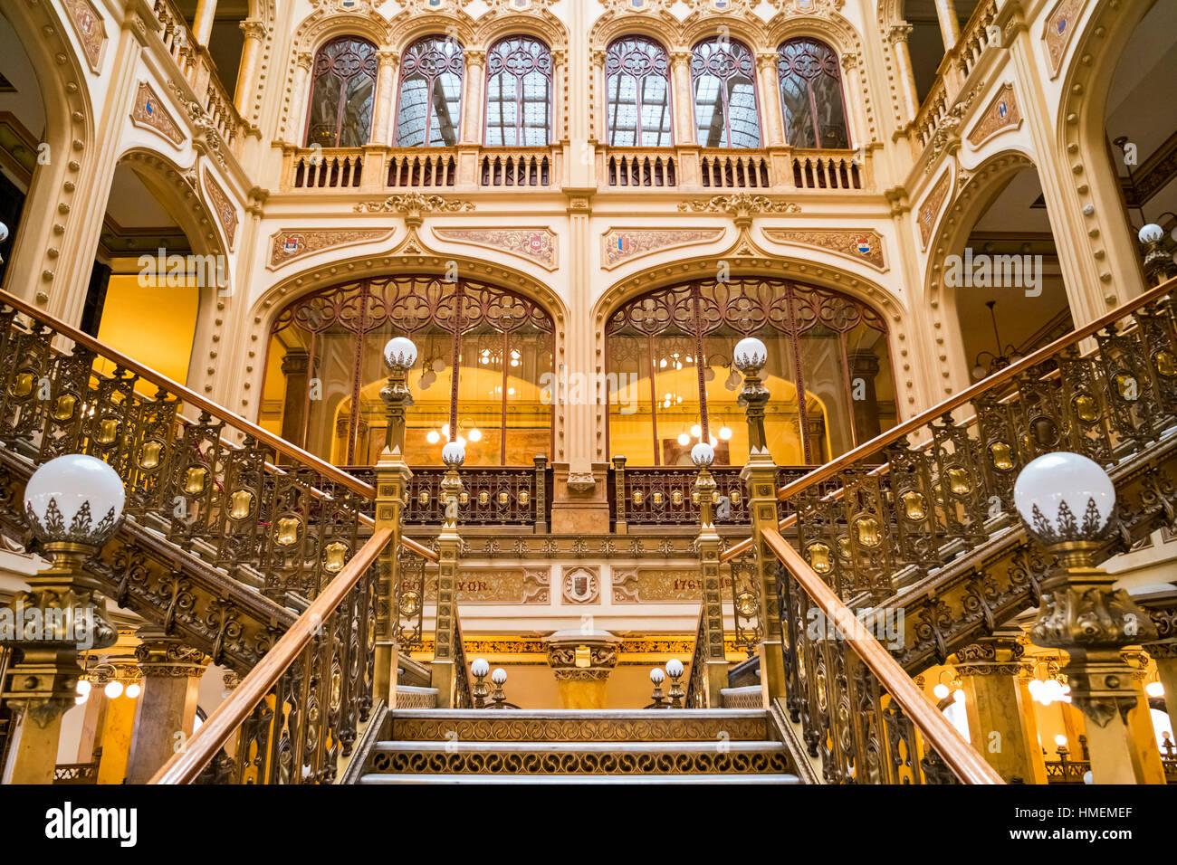 The ornate interior staircase of the landmark Postal Palace (Palacio de Correos de Mexico) located in downtown Mexico Stock Photo
