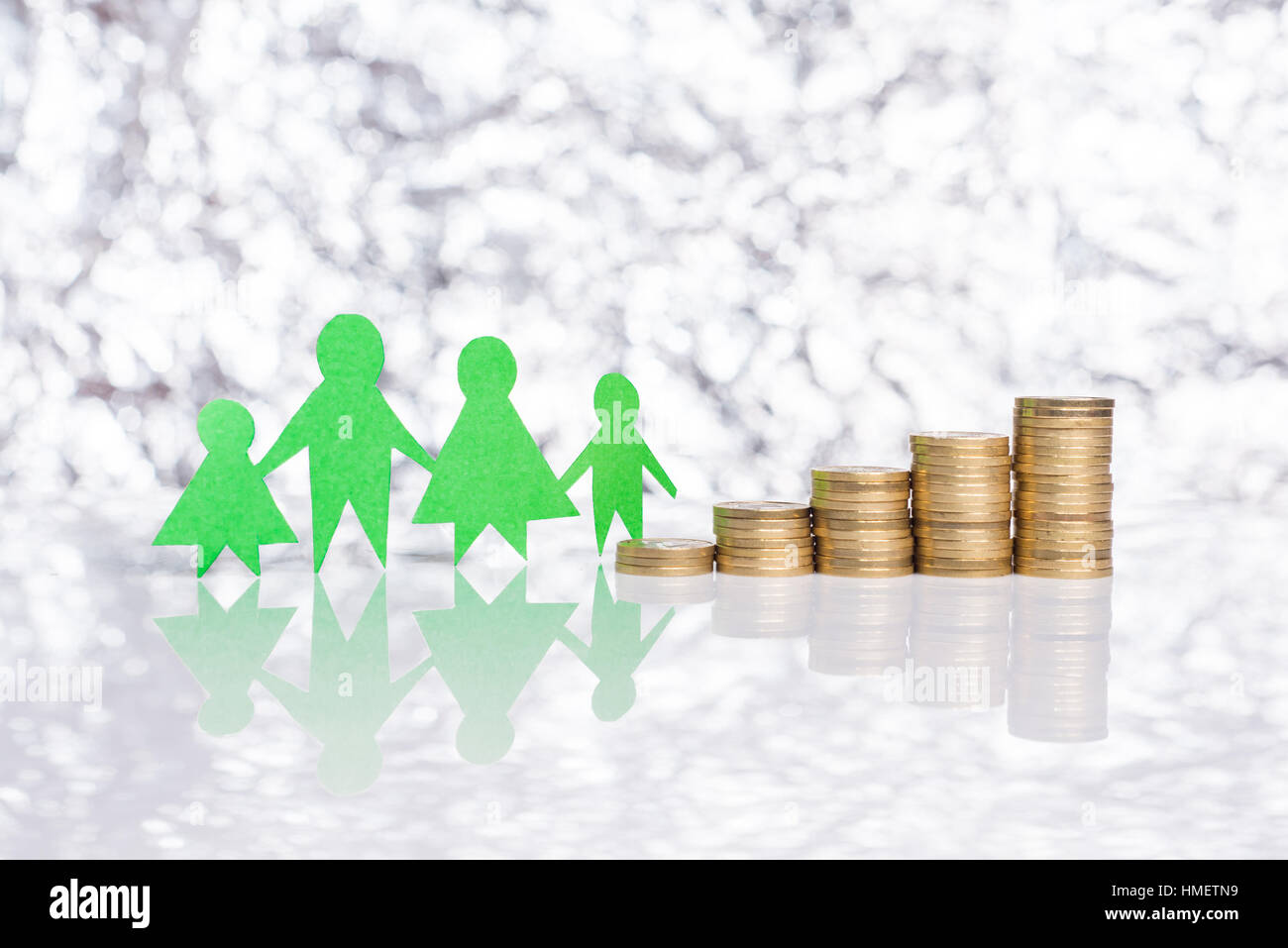 Rising social benefits for families. - Stock Image