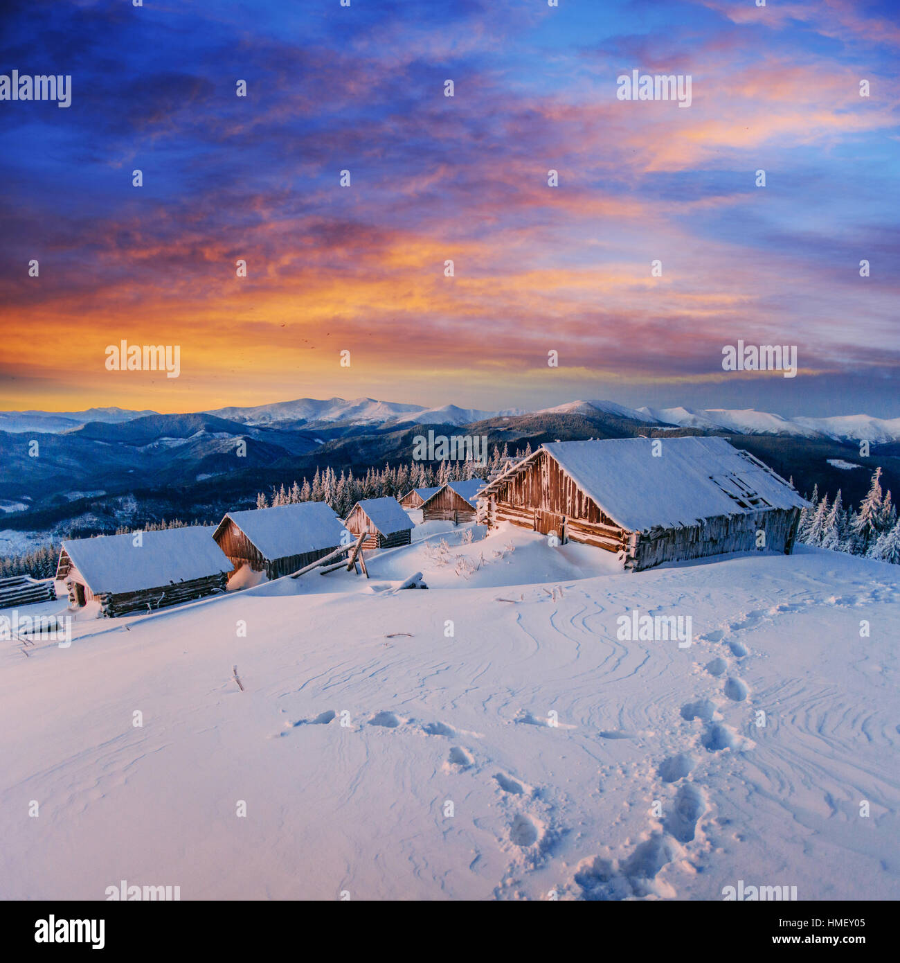 cottage in snowy mountains - Stock Image