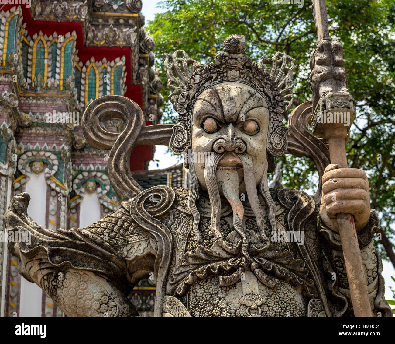 Chinese guardian statue at one of the gates of Wat Pho, in Bangkok (Thailand) - Stock Image