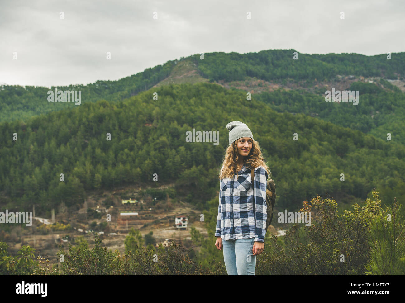Young woman traveler in chekered shirt hiking in the mountains, Dim Cay district of Alanya, Antalya province, Mediterranean - Stock Image
