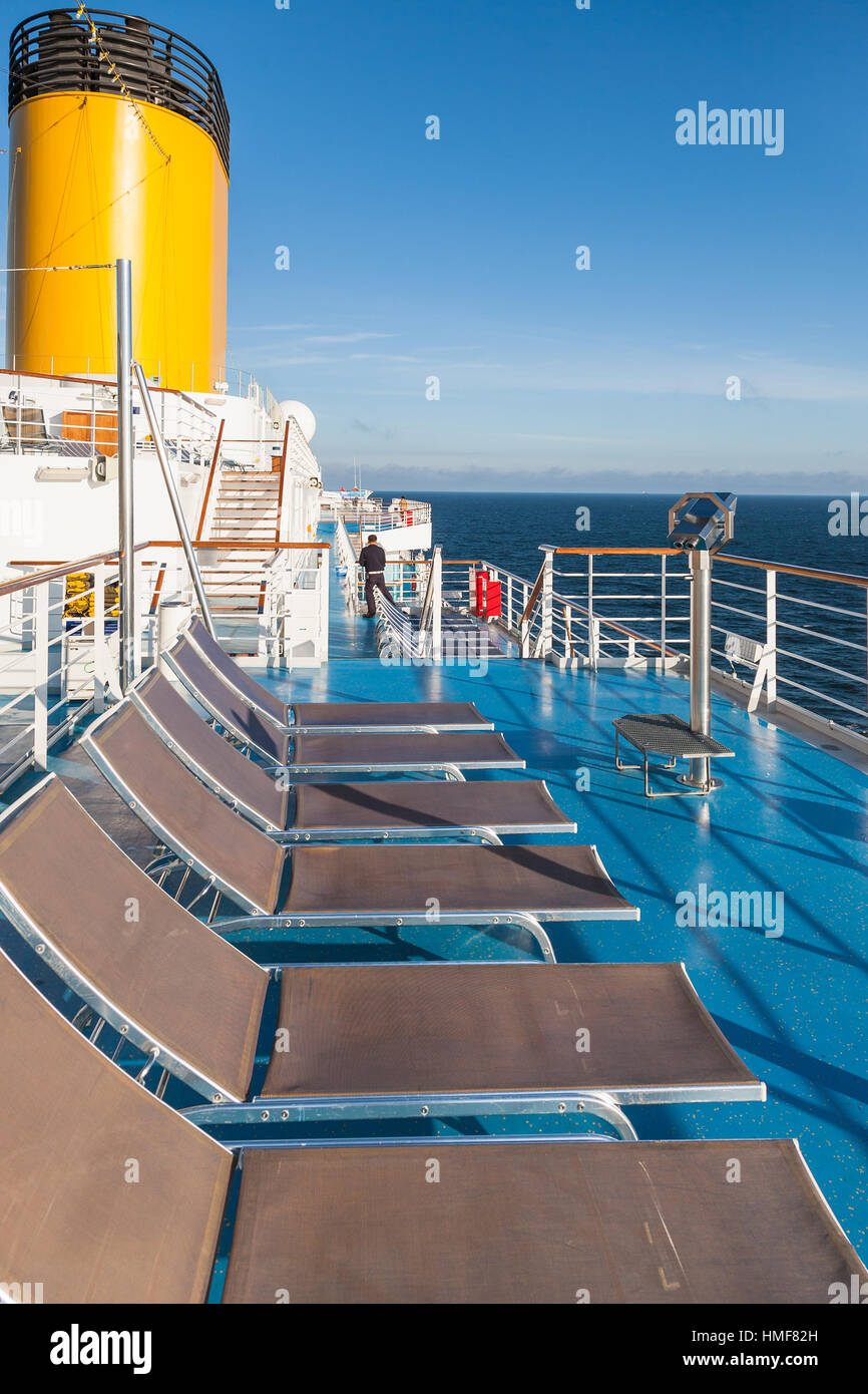 Empty Sunbathing Chairs On Upper Deck Of Cruise Liner