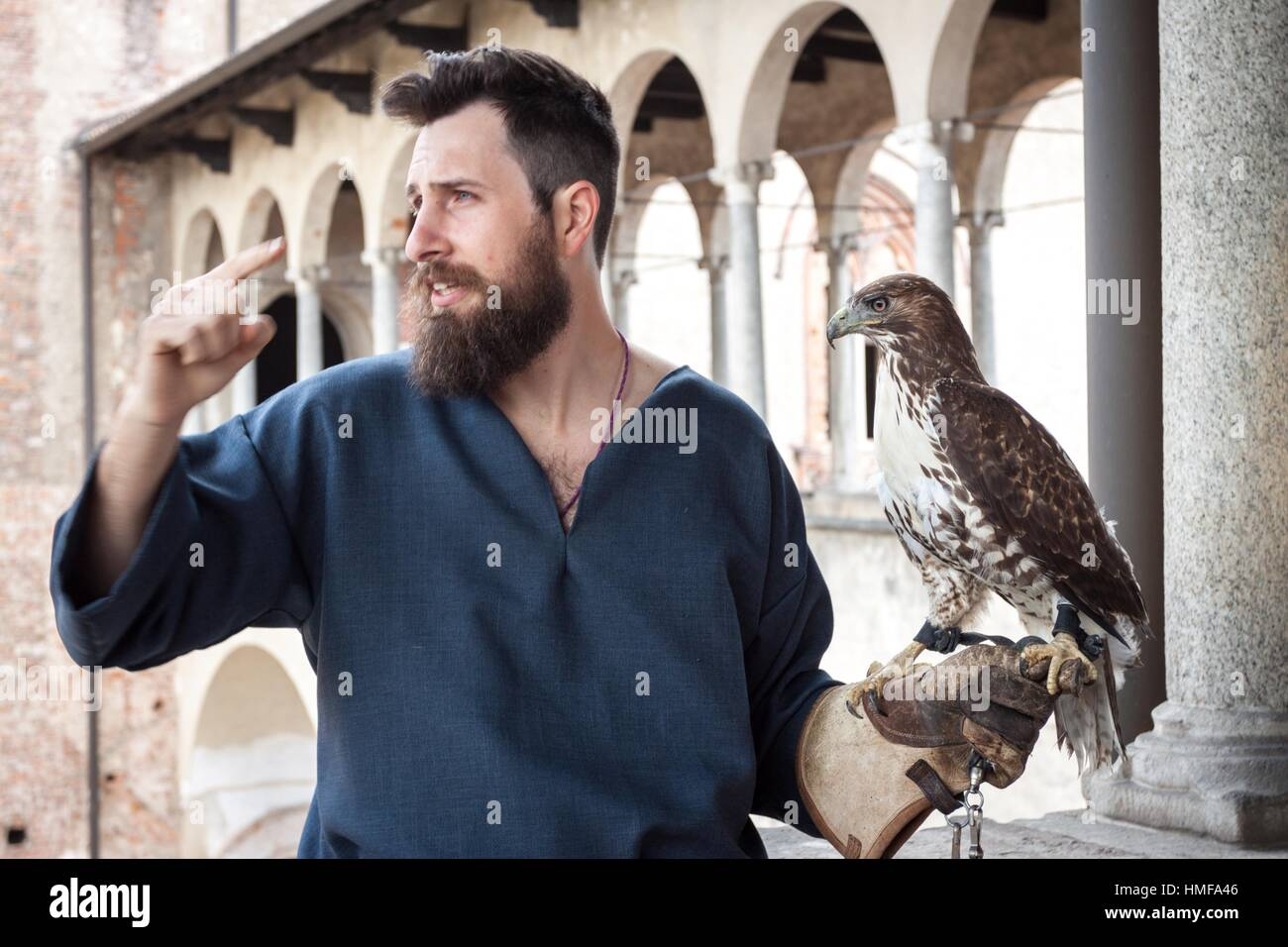 Expert falconer and splendid specimens of rapacious. Vigevano, Lombardy. Italy - Stock Image
