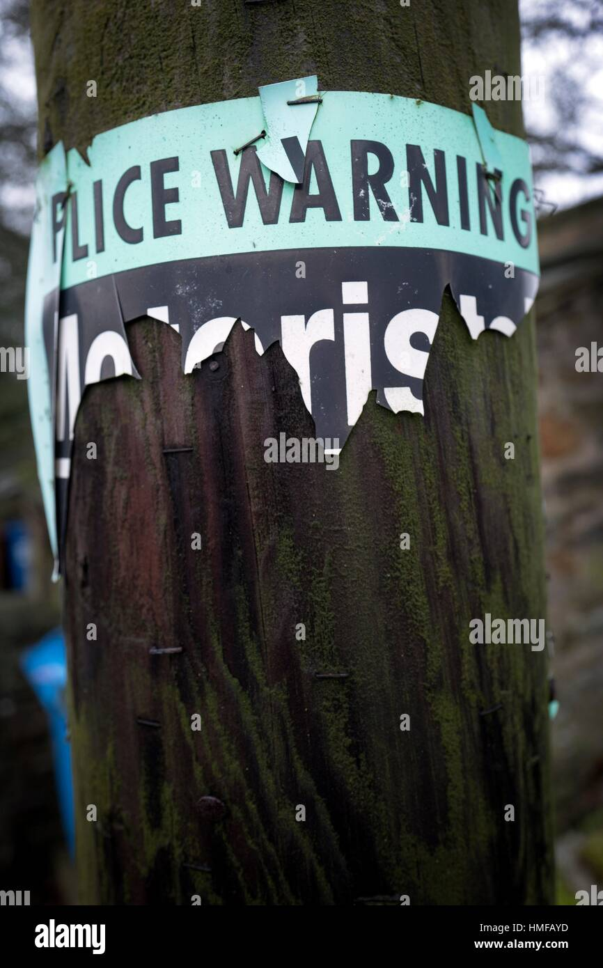 Police Warning sign stuck on a electrical pole. Grassington, Skipton, North Yorkshire, Yorkshire Dales, England, Stock Photo