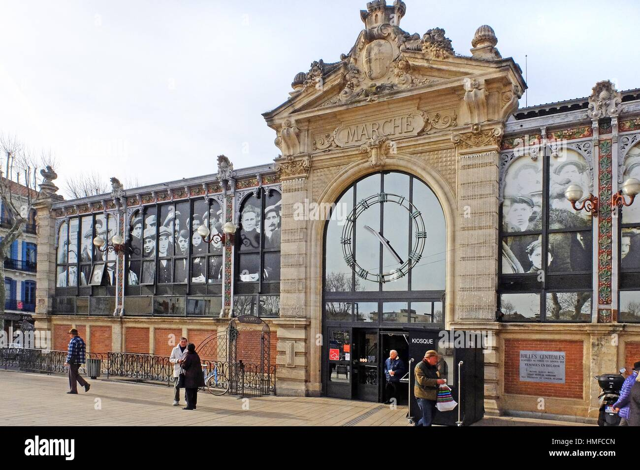 The windows of the ''Halles de Narbonne'' are decorated with photographic images of the people of - Stock Image