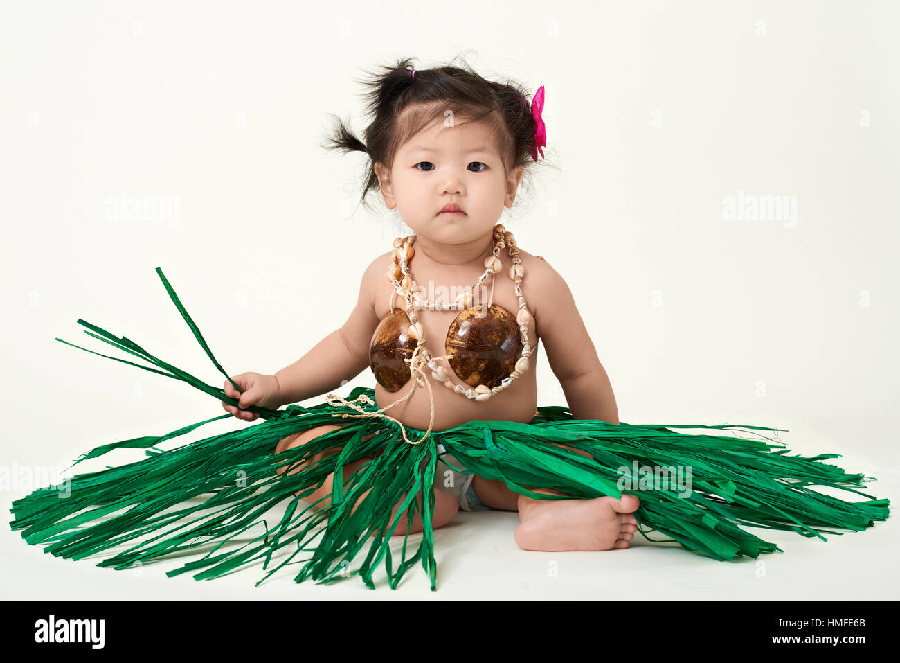 cute asian chinese baby girl dressed in hawaiian outfit stock photo