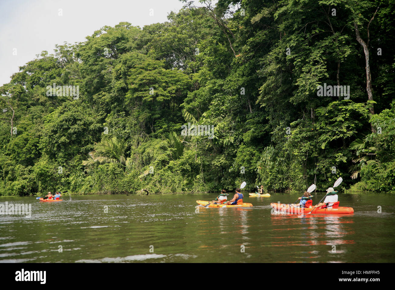 Tourists in kayaks on freshwater canals in Tortuguero National Park, Caribbean coast, Costa Rica. - Stock Image