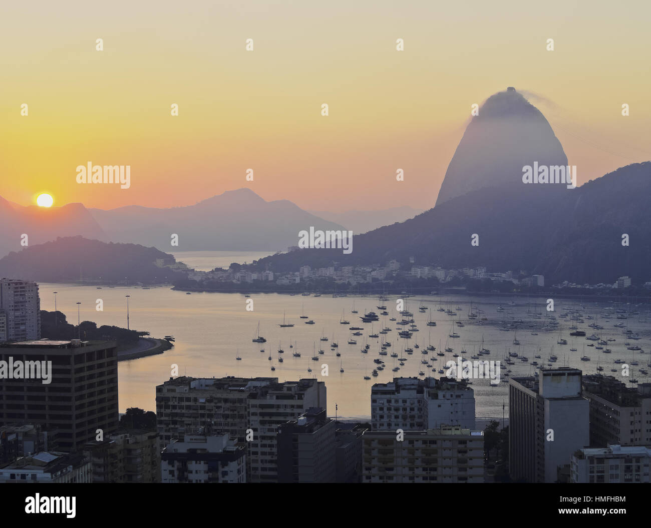 View over Botafogo Neighbourhood towards the Sugarloaf Mountain at sunrise, Rio de Janeiro, Brazil, South America - Stock Image