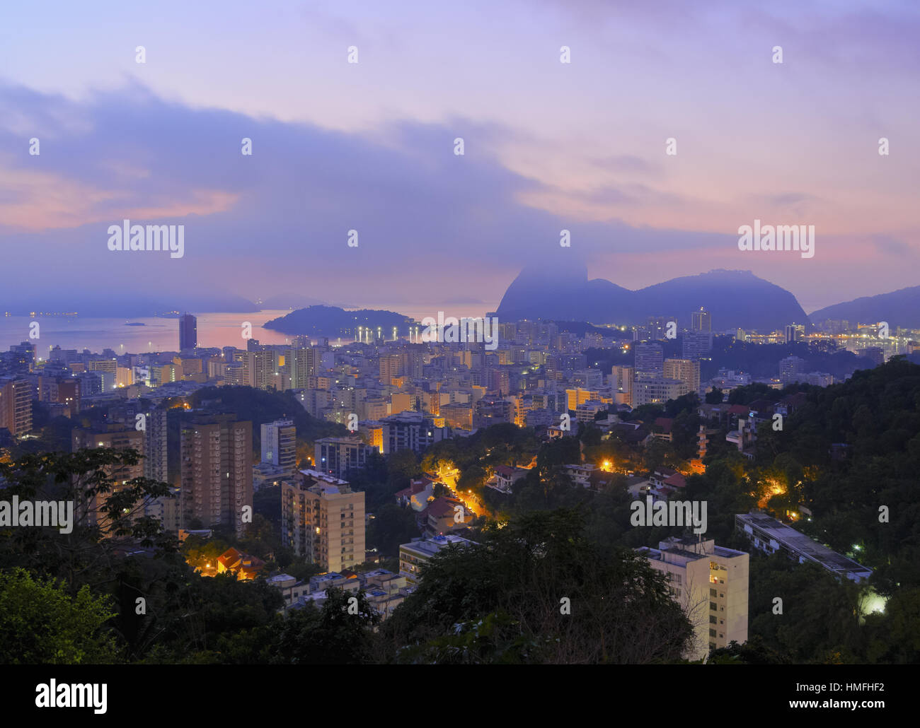 Twilight view over Laranjeiras towards Sugarloaf Mountain, Pereira da Silva, Rio de Janeiro, Brazil, South America - Stock Image