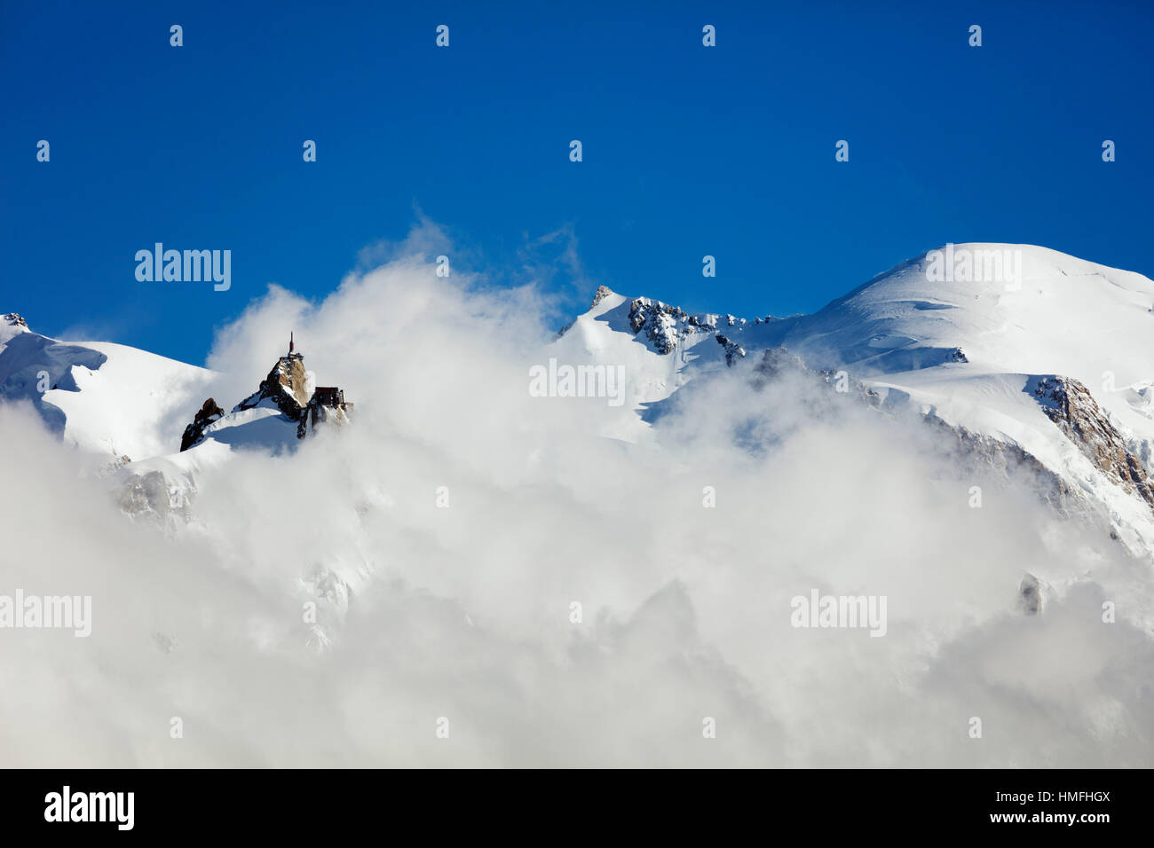 Mont Blanc, 4810m, and Aiguille du Midi cable car station, Chamonix, Haute Savoie, Rhone Alpes, French Alps, France - Stock Image