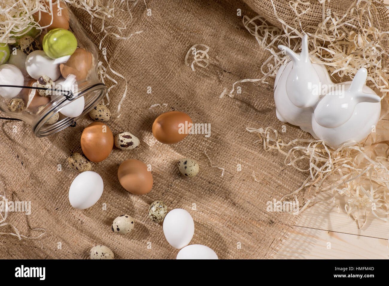 Quail and chicken eggs - Stock Image