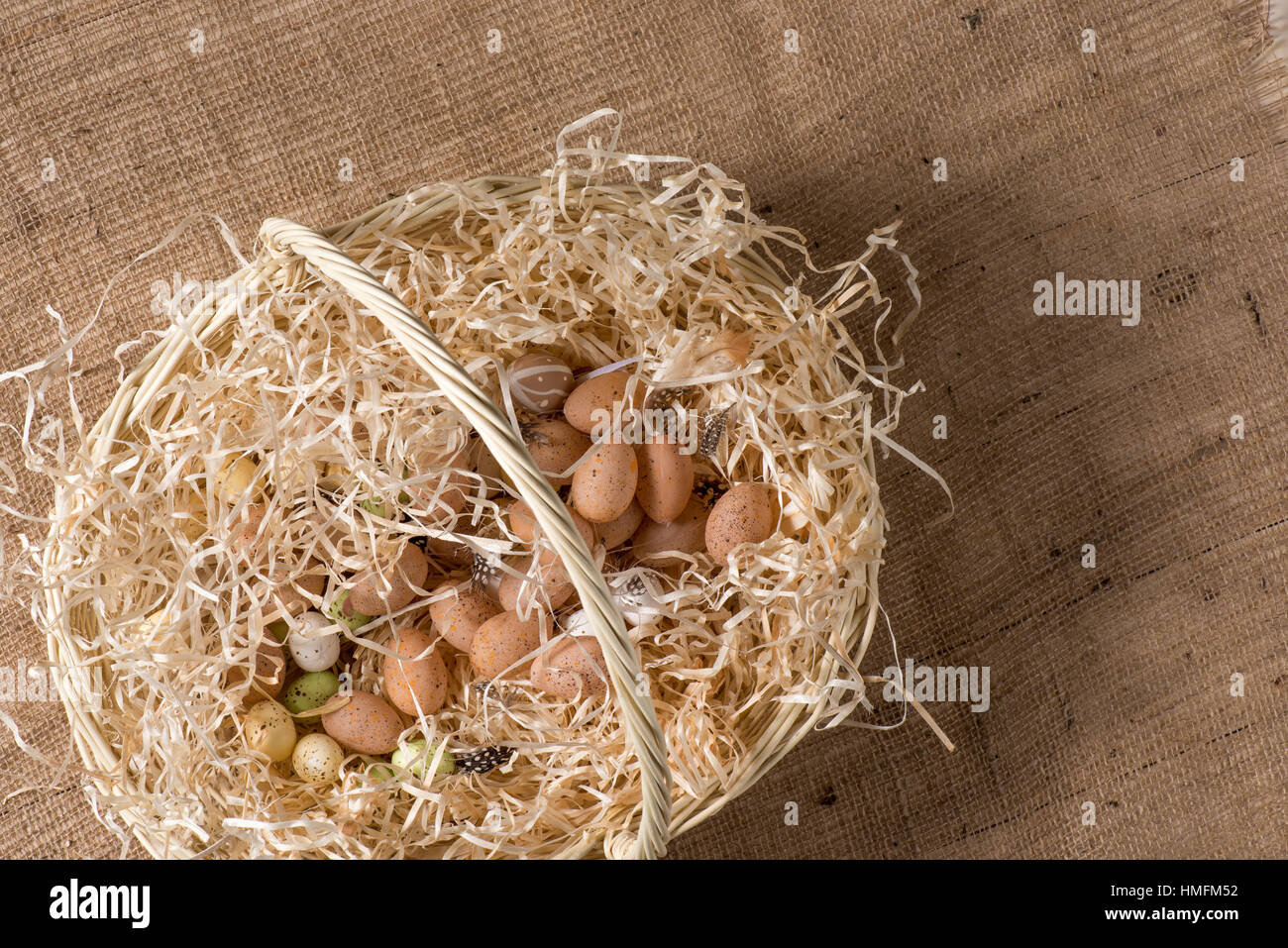 Quail eggs in basket - Stock Image