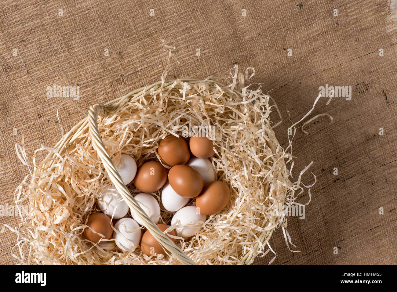 Chicken eggs in basket - Stock Image