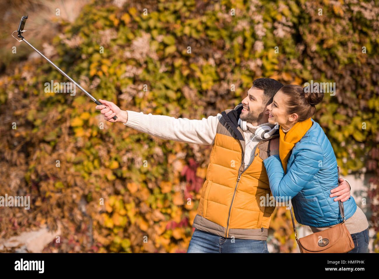 Smiling couple taking selfie Stock Photo
