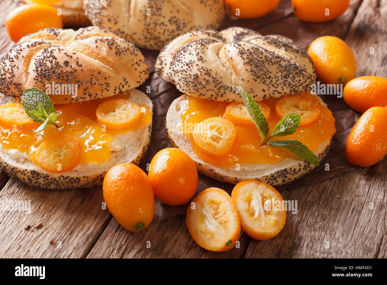 Sweet buns with kumquat jam and cream cheese close-up on the table. horizontal - Stock Image