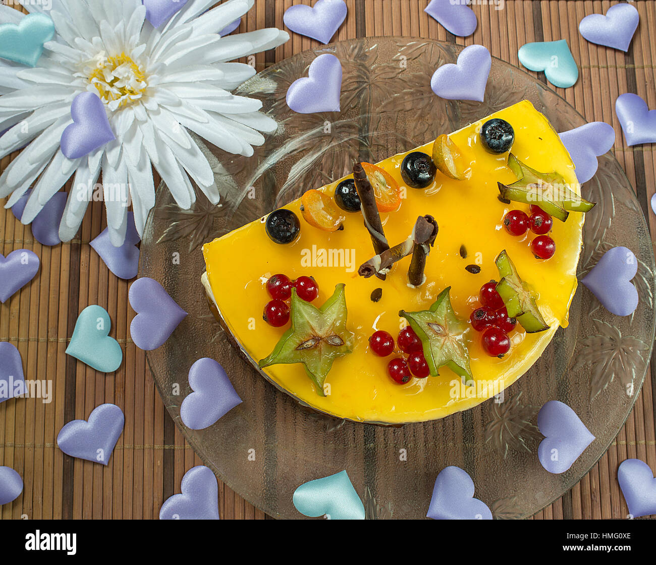 Valentine's cheesecake with berries and the hearts - Stock Image