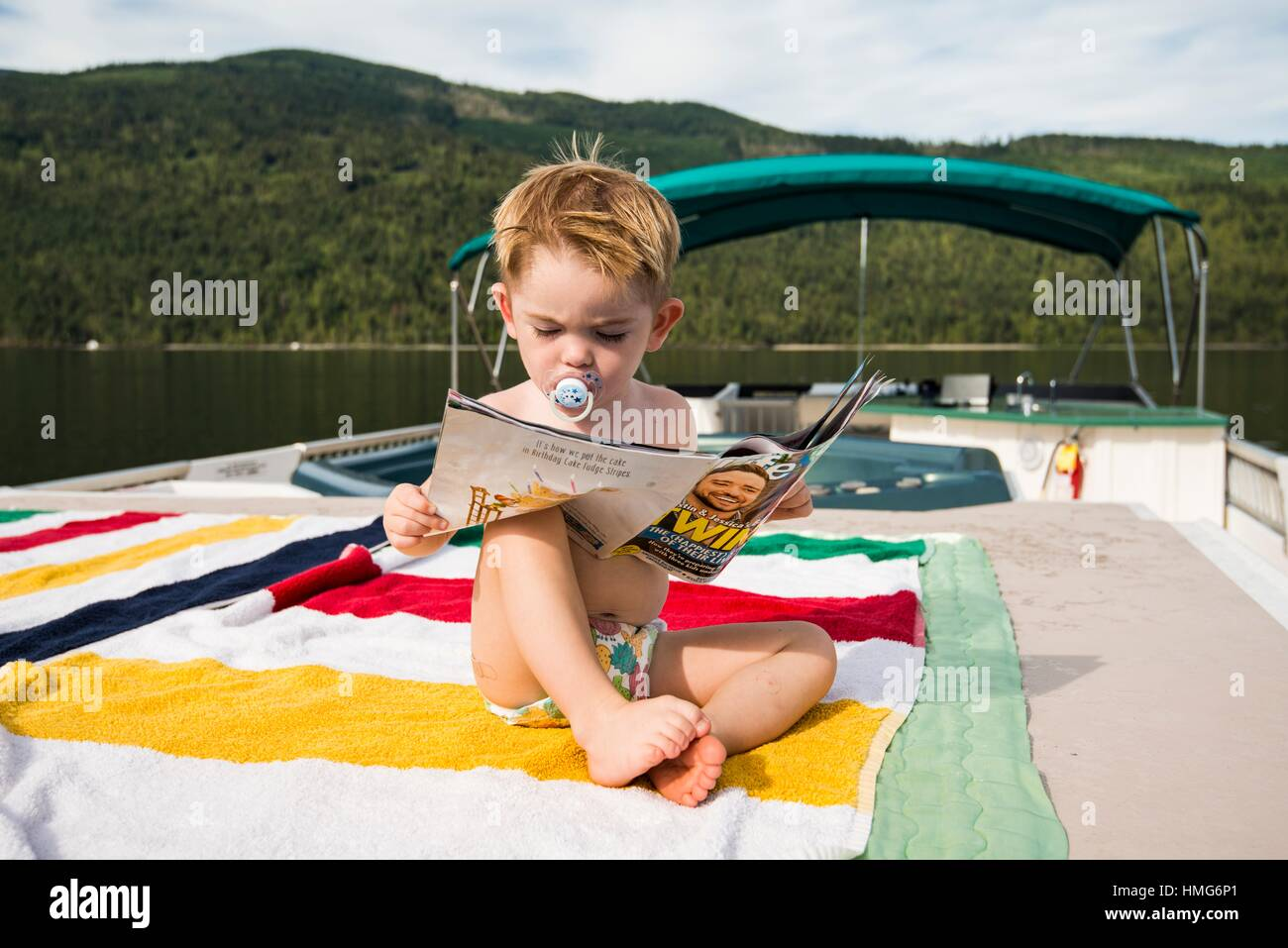 A boy, 2 years, on a house boat on Shushwap Lake in British Columbia, Canada. - Stock Image