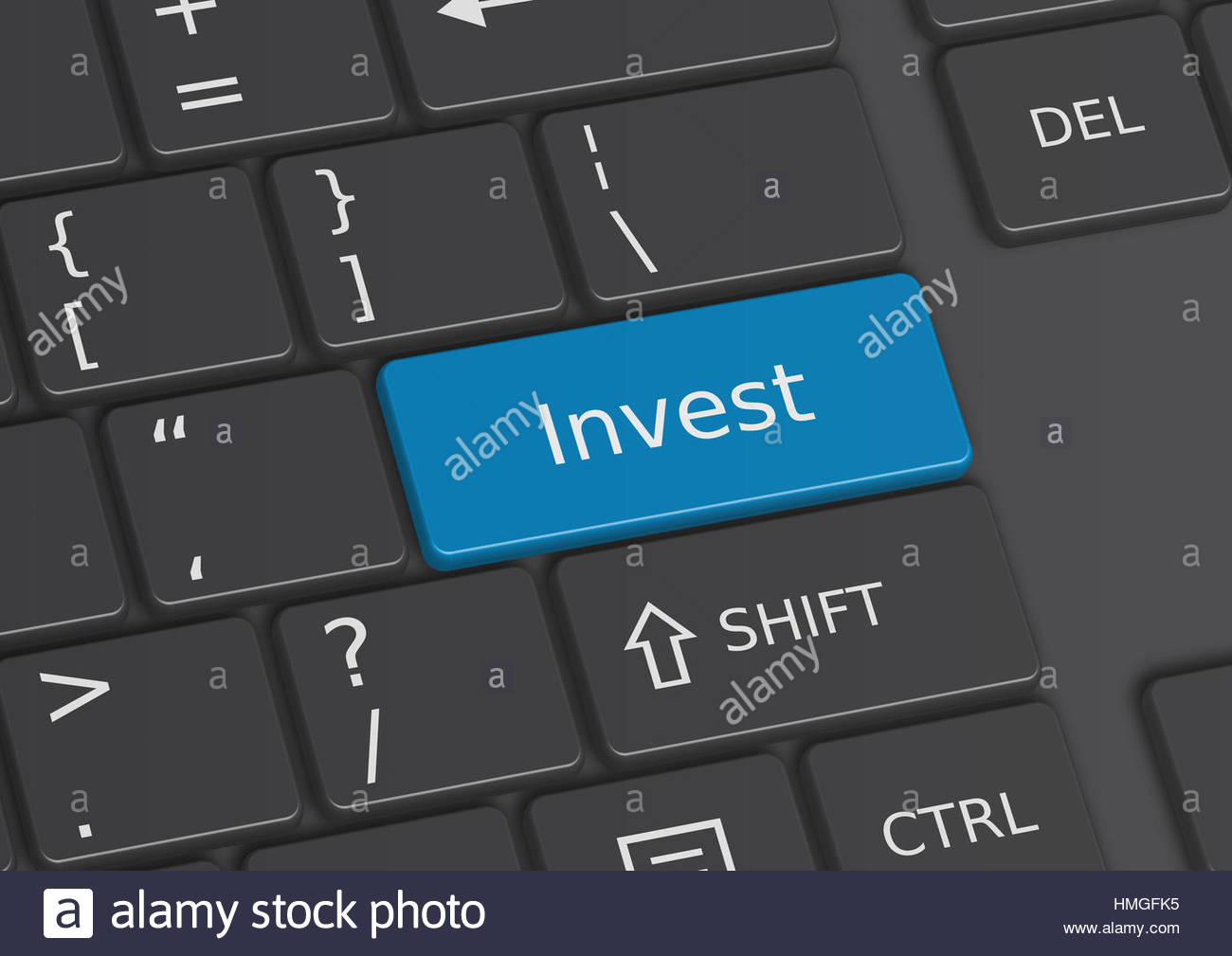The word Invest written on a blue key from the keyboard - Stock Image