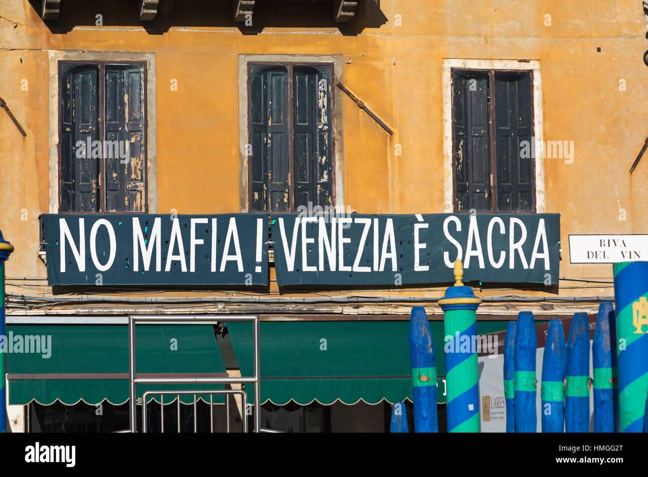 no mafia Venezia e sacra sign on building at no mafia at riva del vin, Grand Canal, Venice, Italy in January - Stock Image