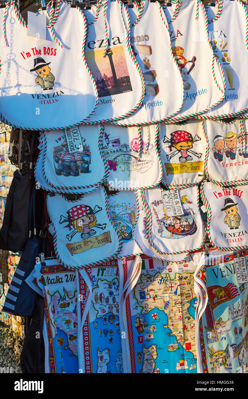 Souvenir baby bibs and tea towels for sale at Venice, Italy in January - Stock Image