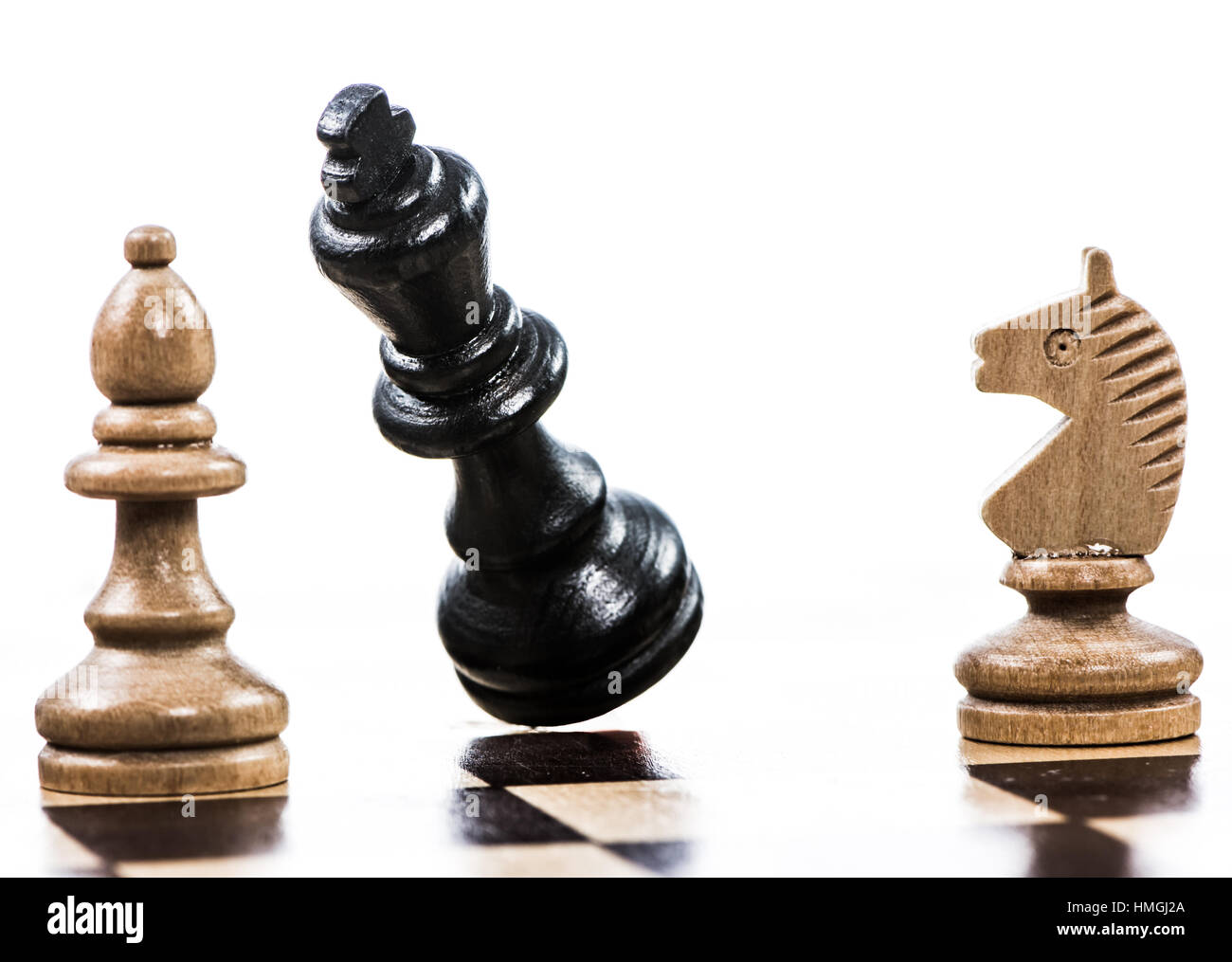 Checkmate - Game of chess with a falling king - Stock Image