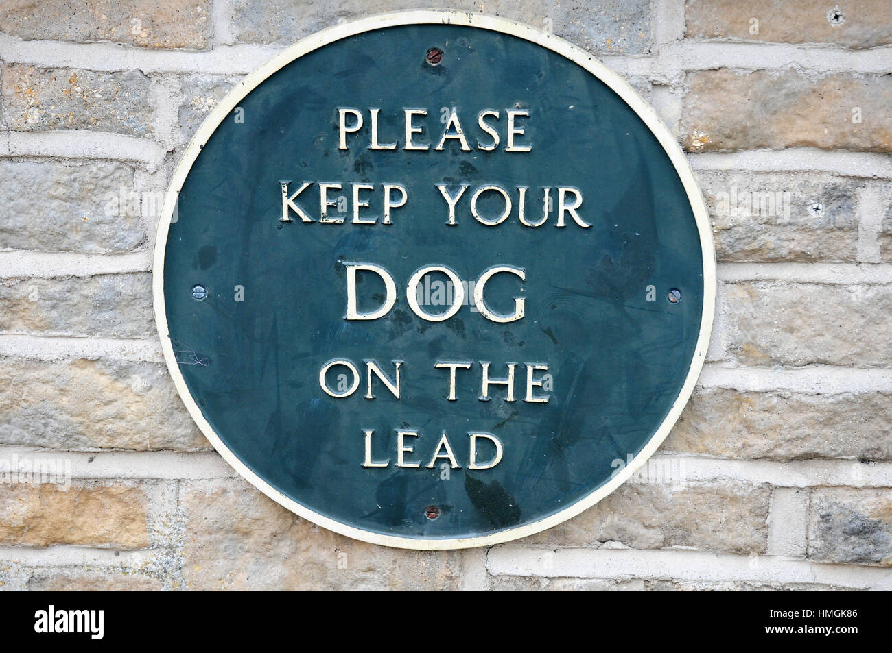Permanent sign requesting people to keep dogs on the lead.  Barnstaple. - Stock Image