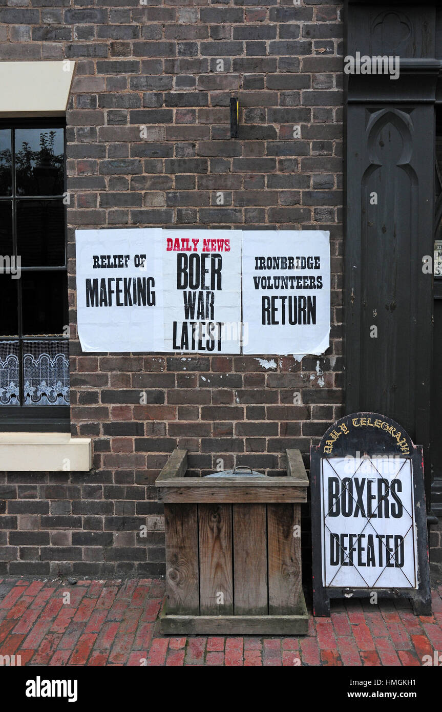 Historic adverts for newspapers, Blists Hill Victorian village. - Stock Image