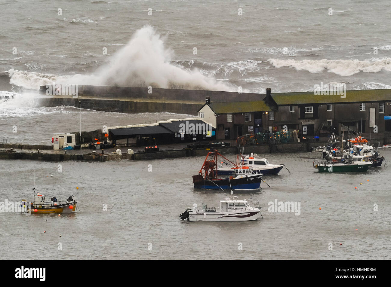 Lyme Regis, Dorset, UK.  3rd February 2017.  UK Weather.  Stormy waves whipped up by gales smash into The Cobb harbour - Stock Image