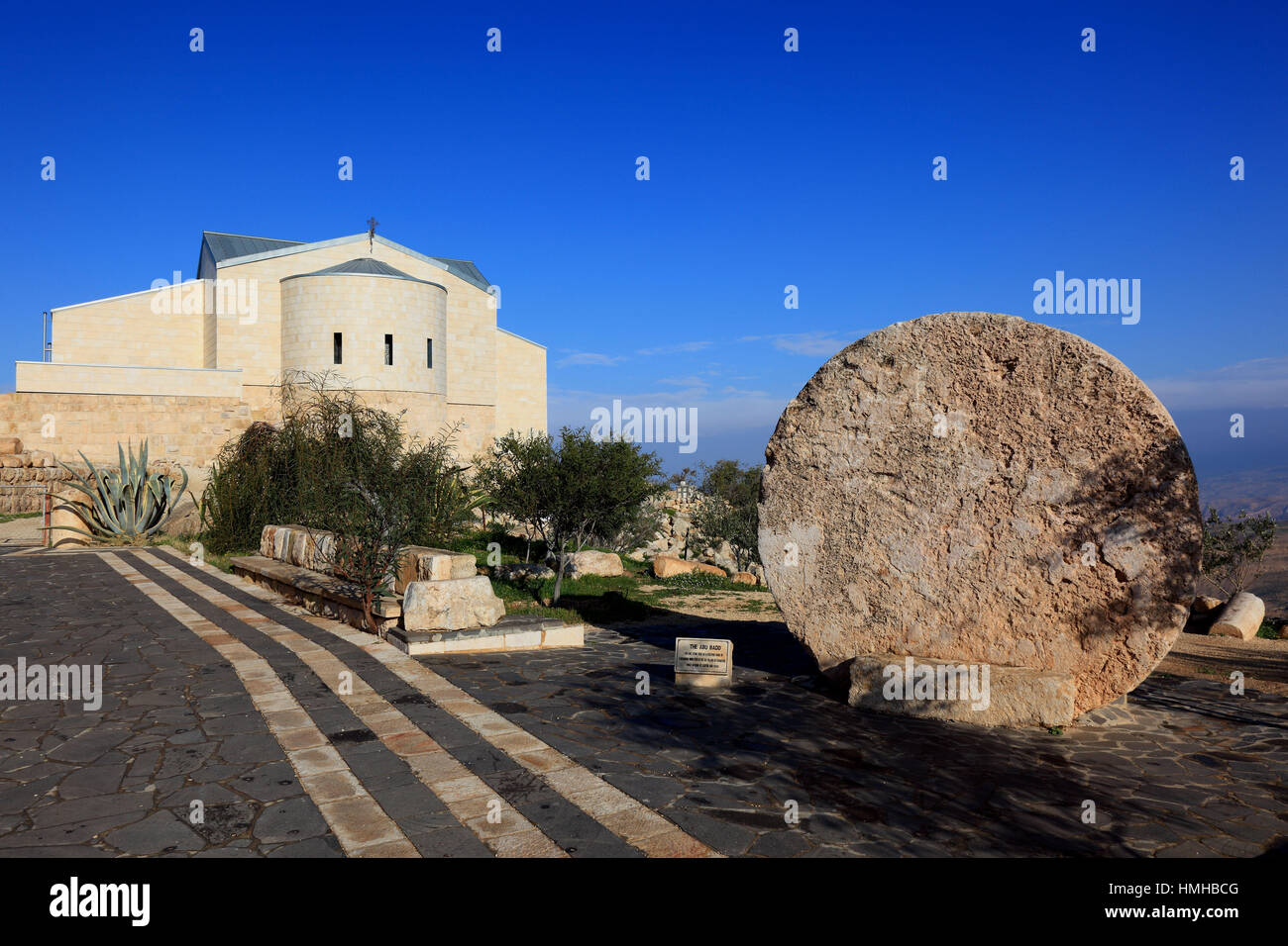rolling stone and Mose church on top of Mount Nebo, Jordan - Stock Image
