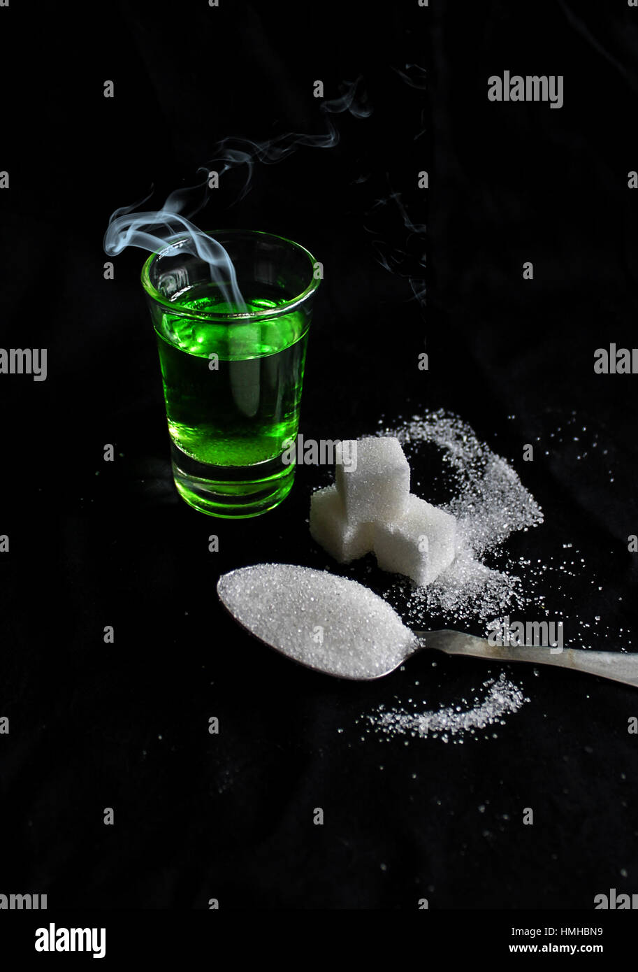 absinthe with sugar cubes and spoon flat lay composition - Stock Image
