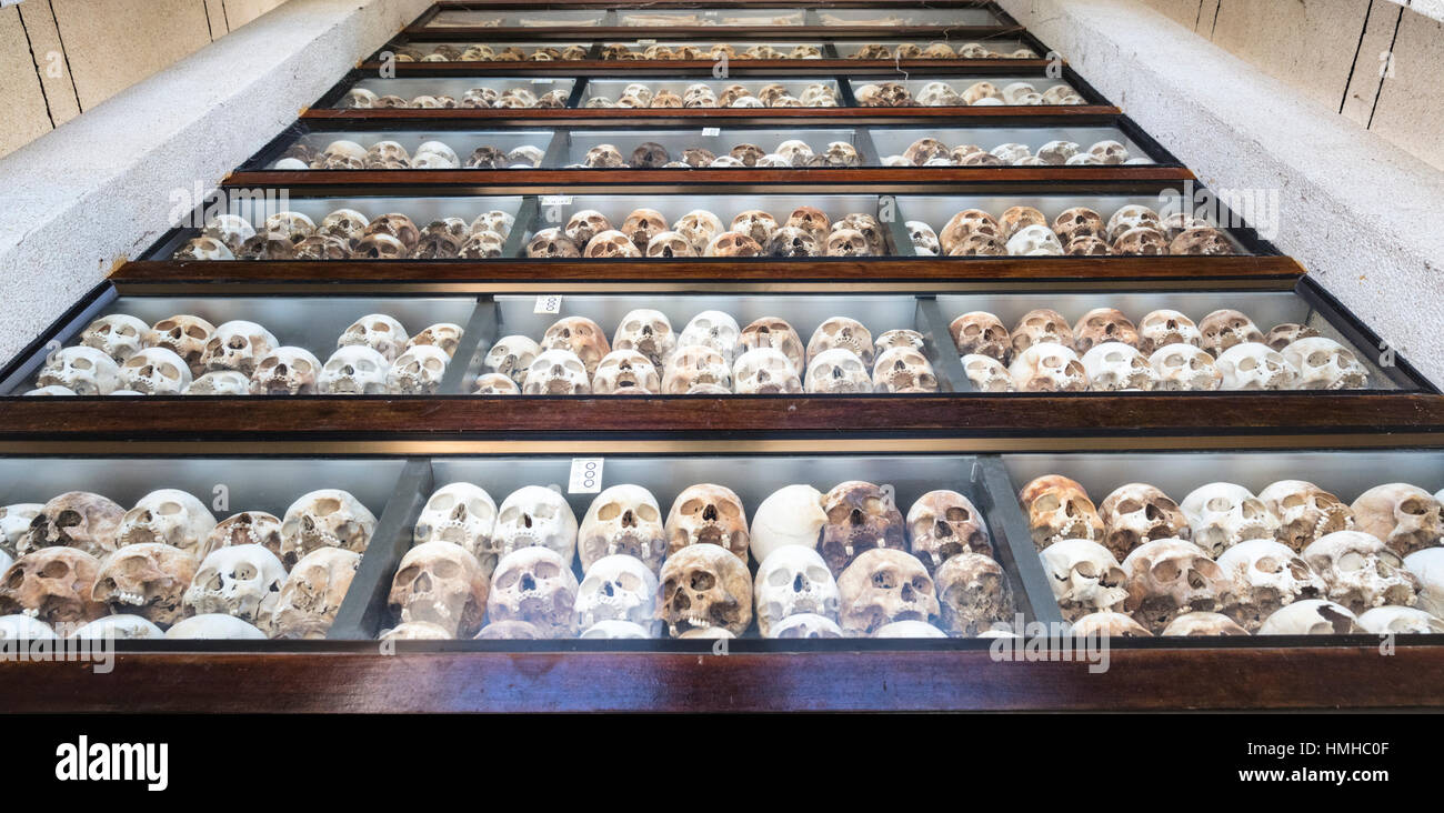 Rows of Skulls of Khmer Rouge victims on display in memorial stupa at the Choeung Ek Killing Field, Phnom Penh, - Stock Image