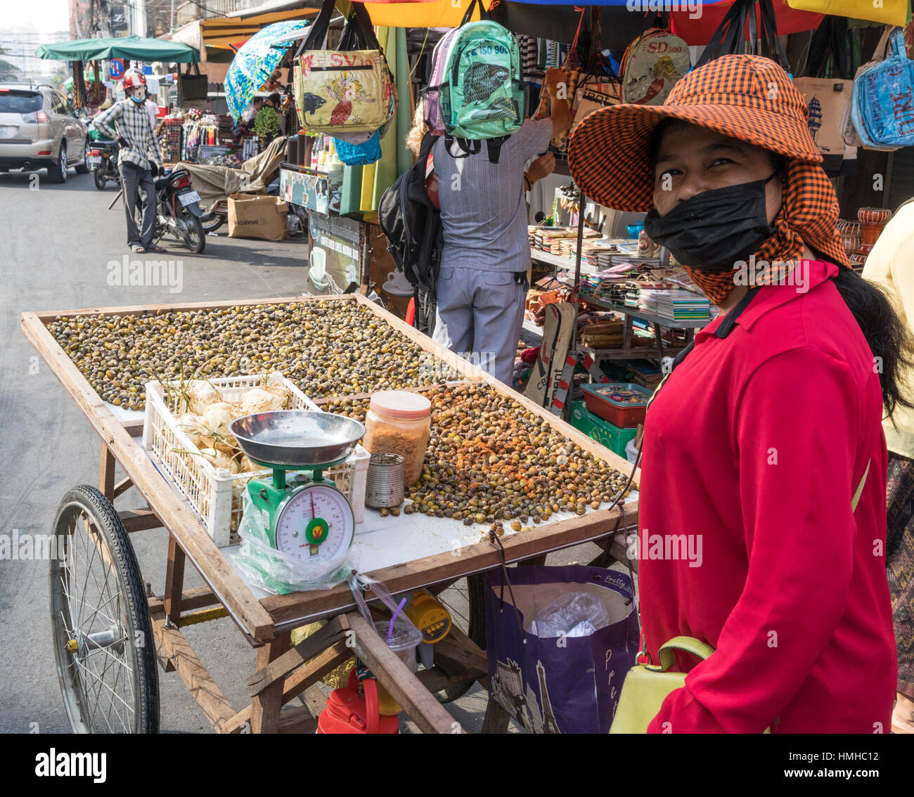 Cockle (mussel) seller and cart, Russian Market, Phnom Penh, Cambodia - Stock Image