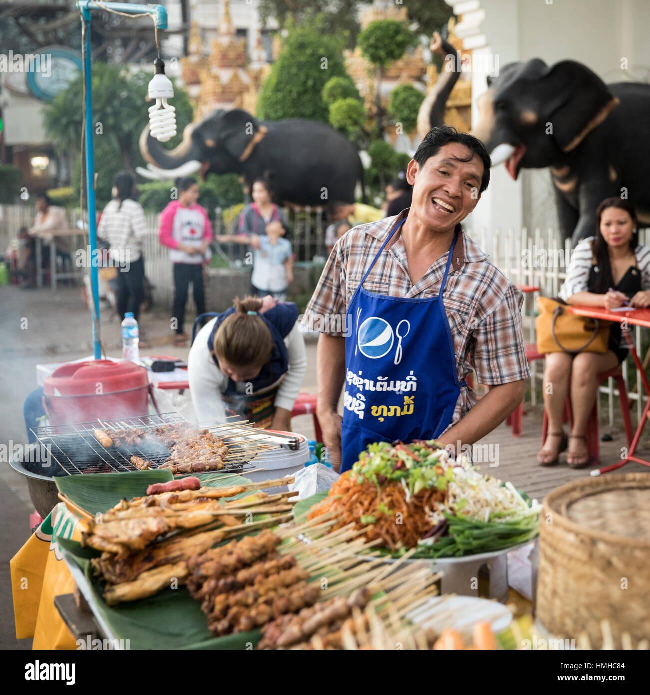 Grilled Meat Vendor at Quai Fa Ngoum near Wat Chan, Vientiane, Laos - Stock Image