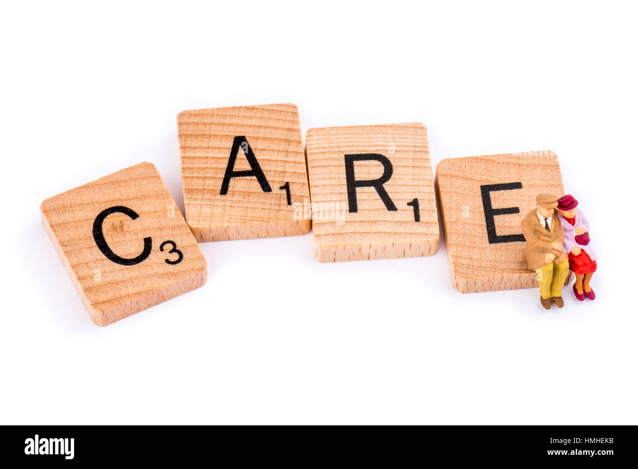 Scrabble Letters Make Up The Word Care An Elderly Couple Sit On The