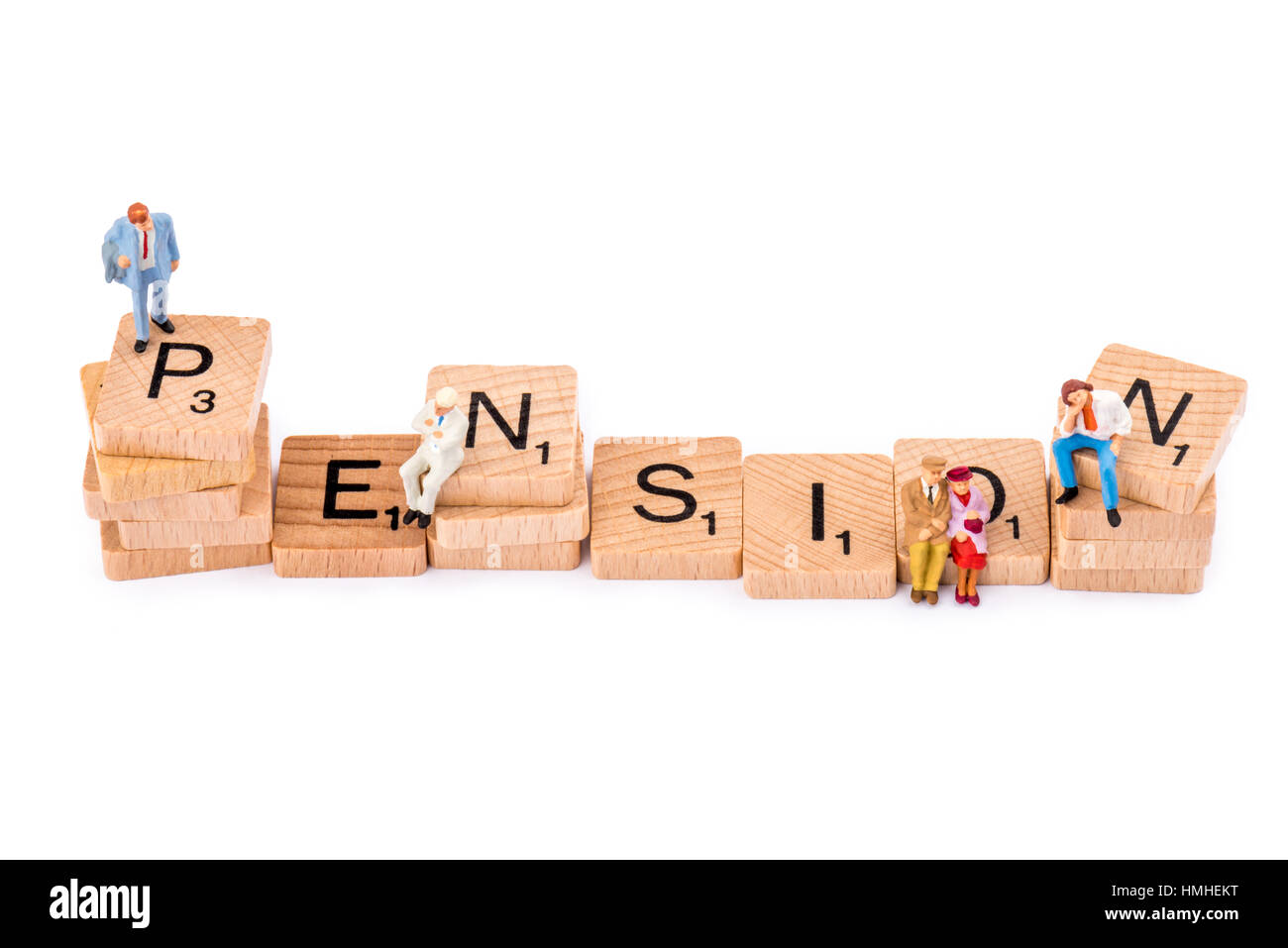 Scrabble letters make up the word PENSION. Figures stand or sit on various letters. - Stock Image