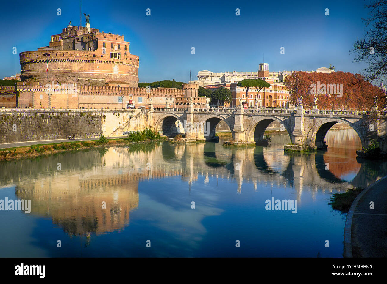 Midday Reflections of the Holy Angel Castle and Bridge in  Tiber River, Rome, Lazio, Italy - Stock Image