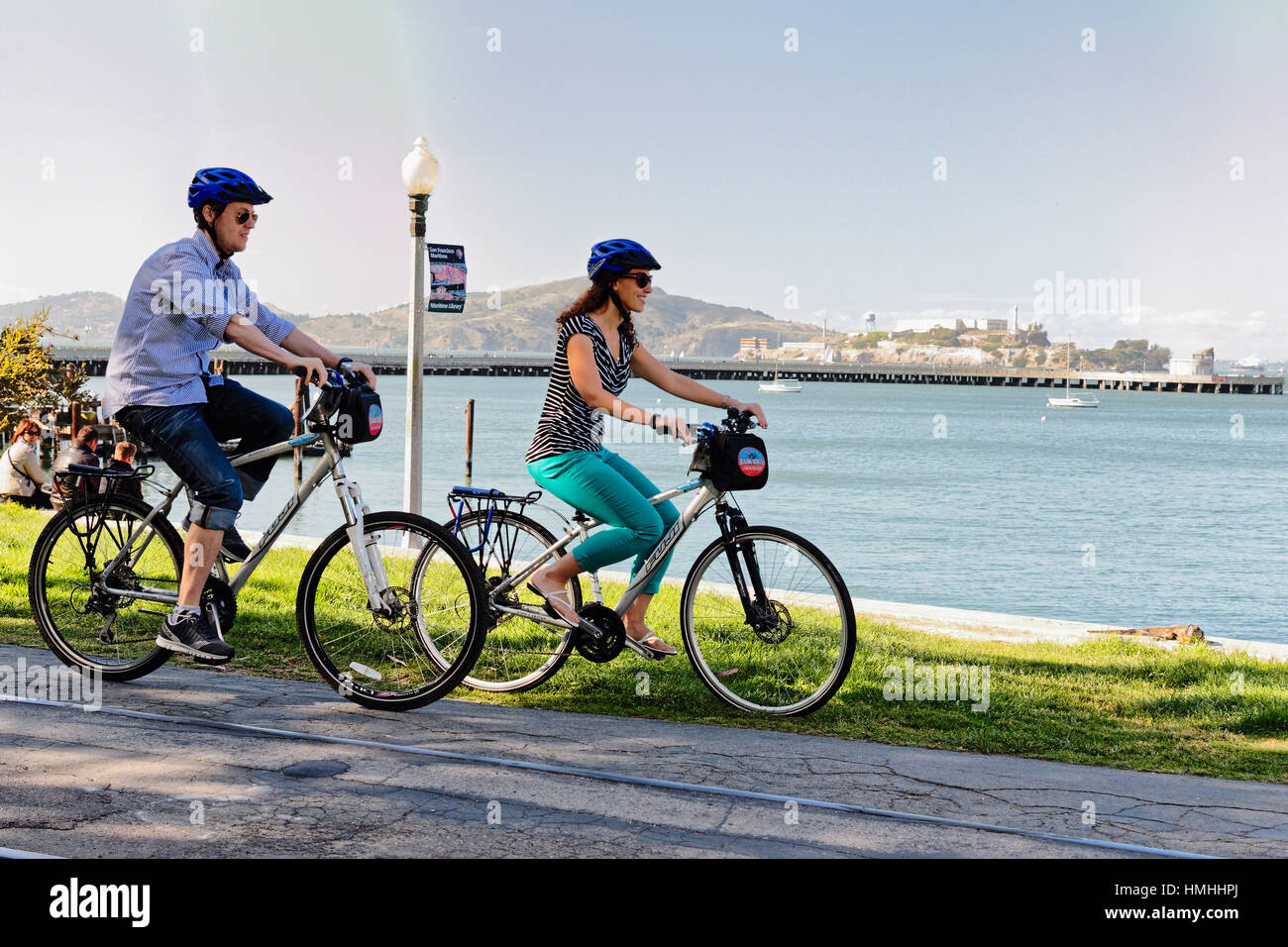 Couple Bicycling on a Path Along San Francisco Bay, California, USA - Stock Image