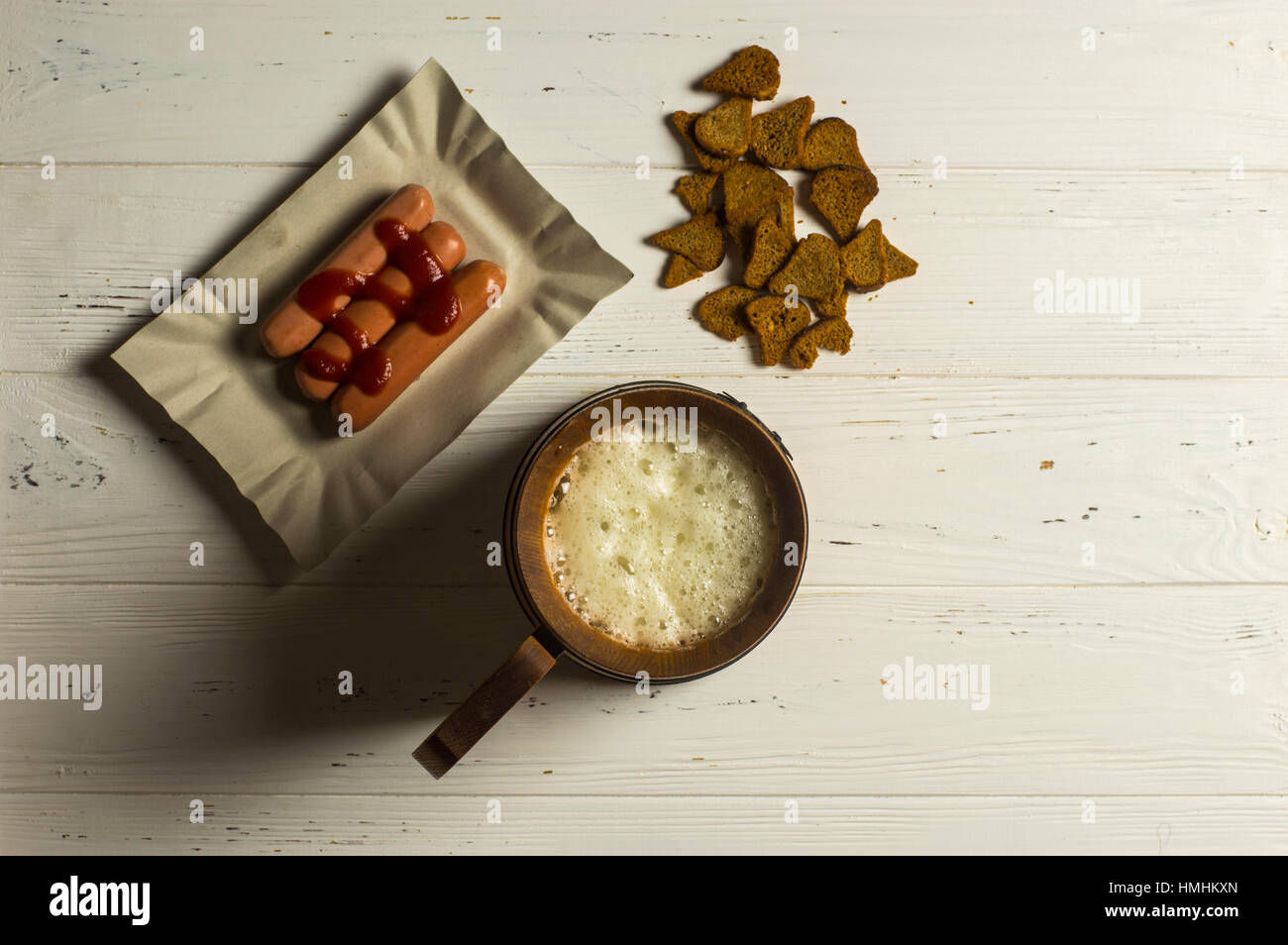 Mug of Beer, Sausage, and Dried Bread on Wooden background Stock Photo