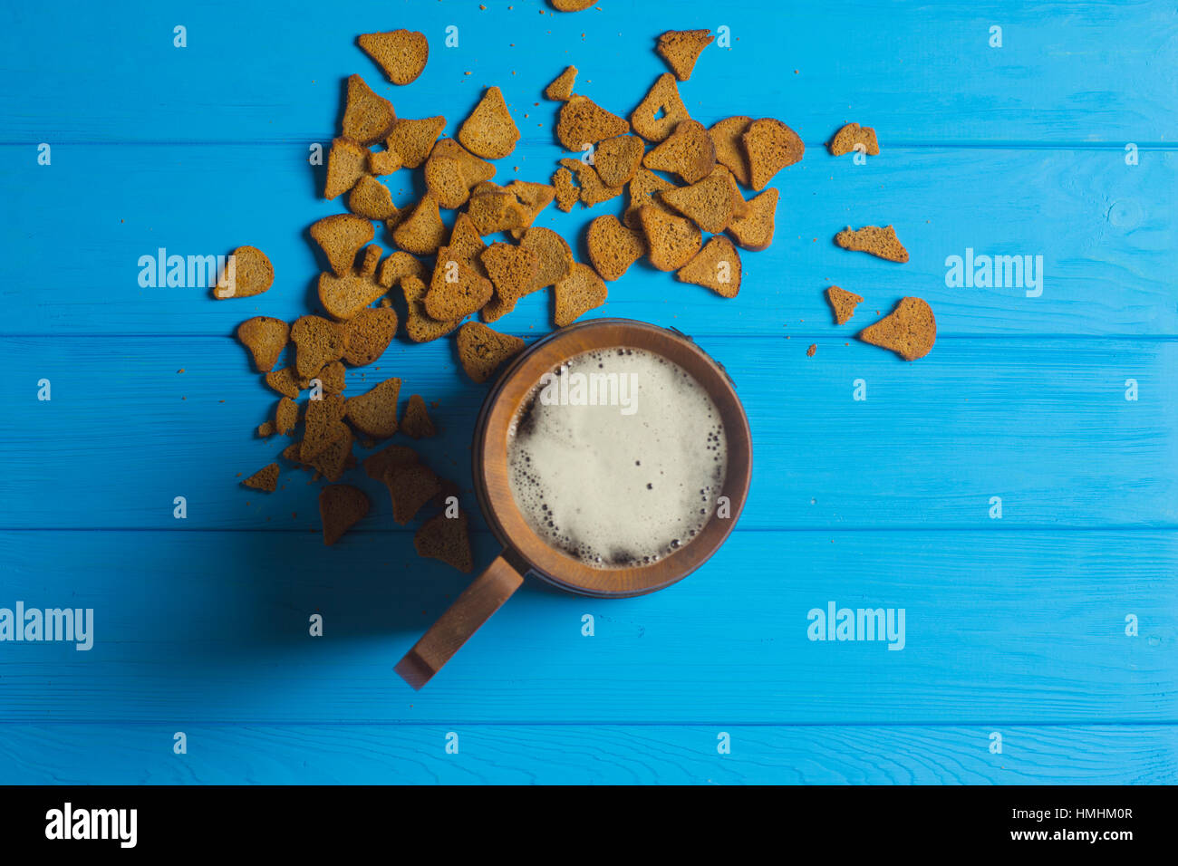Beer Mug and Dried Bread on Wooden Background Stock Photo