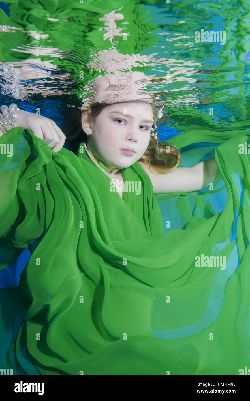 3b0256aa4a57 'Play fashion junior', girl in long, green dresses wearing poses underwater,